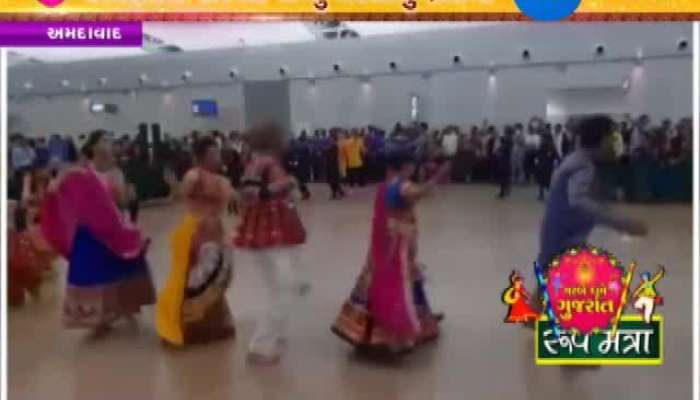 see the visuals people are playing garba at ahmedbad air port