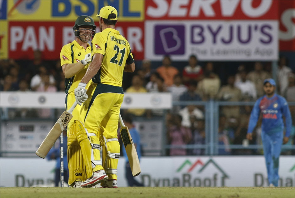 Moises Henriques and Travis Head of Australia celebrate after winning the second T20 match Against India at Barsapara Cricket Stadium in Guwahati.