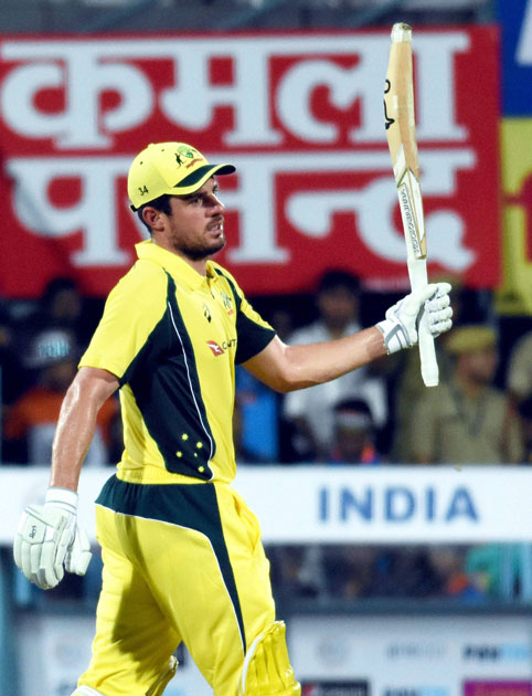 Australian player Moises Henriques celebrates his fifty runs during their second T20 cricket match against India, in Guwahati.