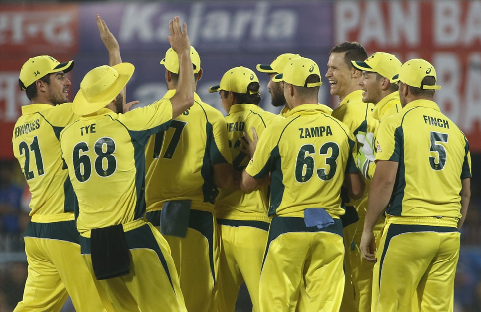 Australia`s Jason Behrendorff, celebrates fall of Virat Kohli`s wicket during the second T20 match between India and Australia at Barsapara Cricket Stadium in Guwahati.