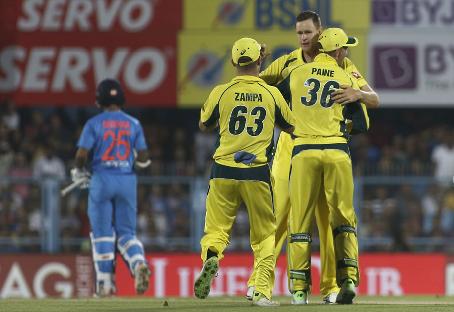 Australia`s Jason Behrendorff, celebrates fall of Rohit Sharma`s wicket during the second T20 match between India and Australia at Barsapara Cricket Stadium in Guwahati.