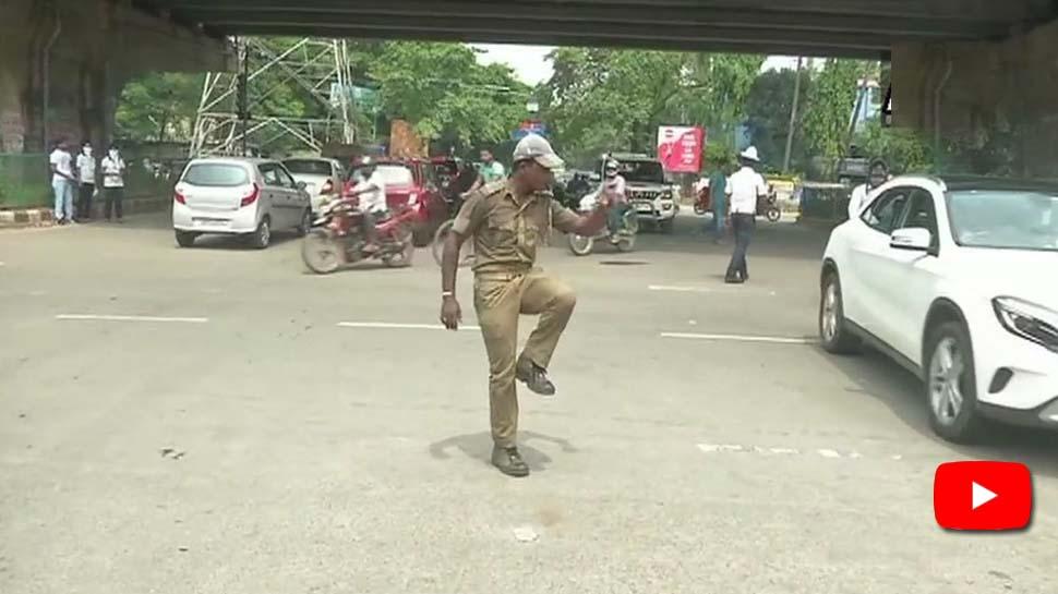 Video: நடன அசைவுகளால் போக்குவரத்தை கட்டுப்படுத்தும் காவலர்!